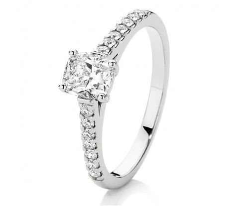 This engagement ring features 0.90ct of brilliant cut diamonds TDW, including a 0.70ct cushion cut Canadian Fire centre stone and set in 18ct white gold