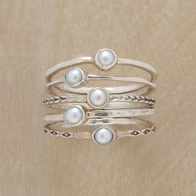 Five cultured pearls are bezel set atop thread-thin silver bands, each different—polished, hammered and engraved. Handmade exclusively for Sundance. Whole and half sizes 5 to 9. Set of 5.
