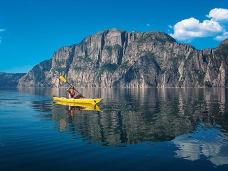 Kayaking at Lysefjorden -Norway Oooooh! Kayaking all day and watching the Northern Lights at night! Would love to go to Norway!
