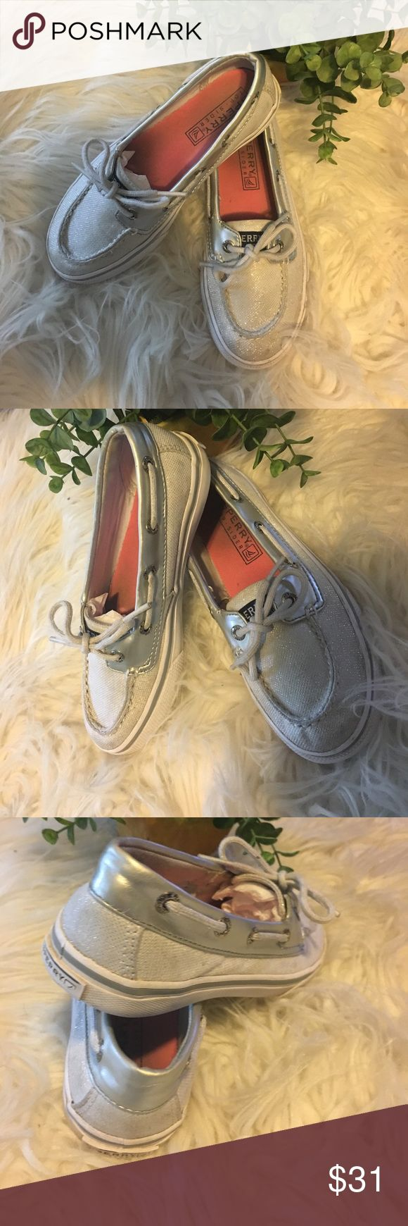 Girls Sperry Top-Siders Adorable pair of Sperry's! Silver and white with touch of sparkles. Lots of life left in these stylish pair of Sperry's! Why buy new when the kids grow right out of their shoes at this age! Overall in very good condition, see last pic for minor flaw, Sperry rubbing off! Sperry Top-Sider Shoes