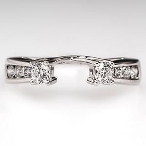Vintage wedding ring wrap.  I haven't received my engagement ring yet, but I know it's high profile. Maybe this'll fit?