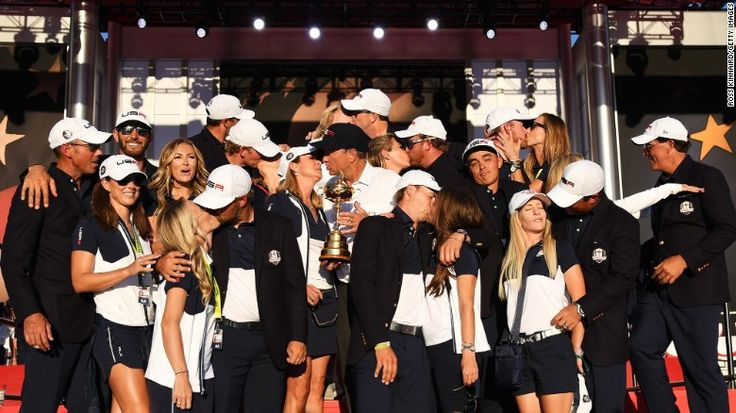 """Golfer Rickie Fowler shrugs as his US teammates kiss their wives and girlfriends <a href=""""http://www.cnn.com/2016/10/03/golf/ryder-cup-2016-reactions-obama-arnold-palmer/index.html"""" target=""""_blank"""">during a team photo</a> on Sunday, October 2. The Americans had just won <a href=""""http://www.cnn.com/2016/10/02/golf/golf-ryder-cup-usa-europe/index.html"""" target=""""_blank"""">their first Ryder Cup since 2008.</a>"""