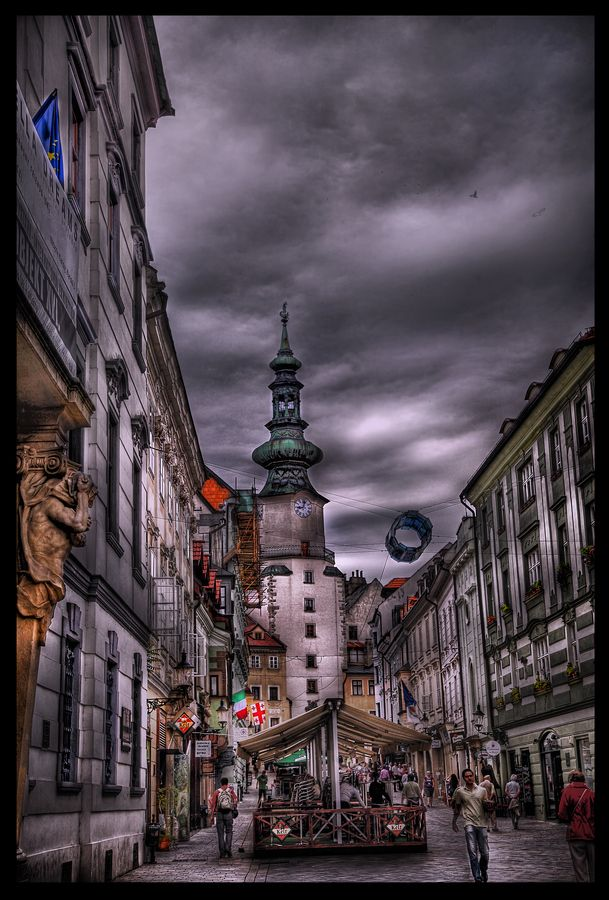 In Bratislava, Slovakia, Michael's Gate is the only city gate that has been preserved of the medieval fortifications and ranks among the oldest town buildings. Built about the year 1300, its present shape is the result of baroque reconstructions in 1758, when the statue of St. Michael and the Dragon was placed on its top.