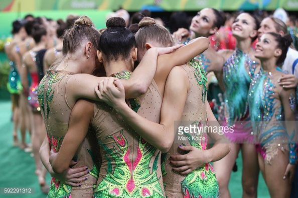 The Brazil team share a moment at the conclusion of the hoop and clubs rotation 2 in the group all-round qualification round at the at Rio Olympic Arena on August 20, 2016 in Rio de Janeiro, Brazil