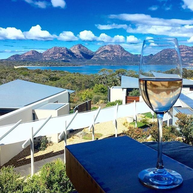 "The sweeping views from your room at @luxurylodgesofaustralia's @saffirefreycinet in @tasmania are best served with a glass of local sparkling wine, especially when it's appropriately named the 'Saffire Pink Vintage Sparkling', of course! @lizajanesowden said she could ""sit right here for days and watch Mother Nature's theatrics play out"", and with a balcony view like this one over the Freycinet National Park and the Hazards mountain range, you can't really blame her! #RestaurantAustralia"