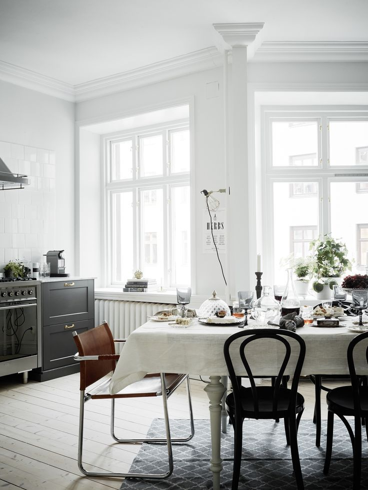 white wall + black kitchen  airy dining space