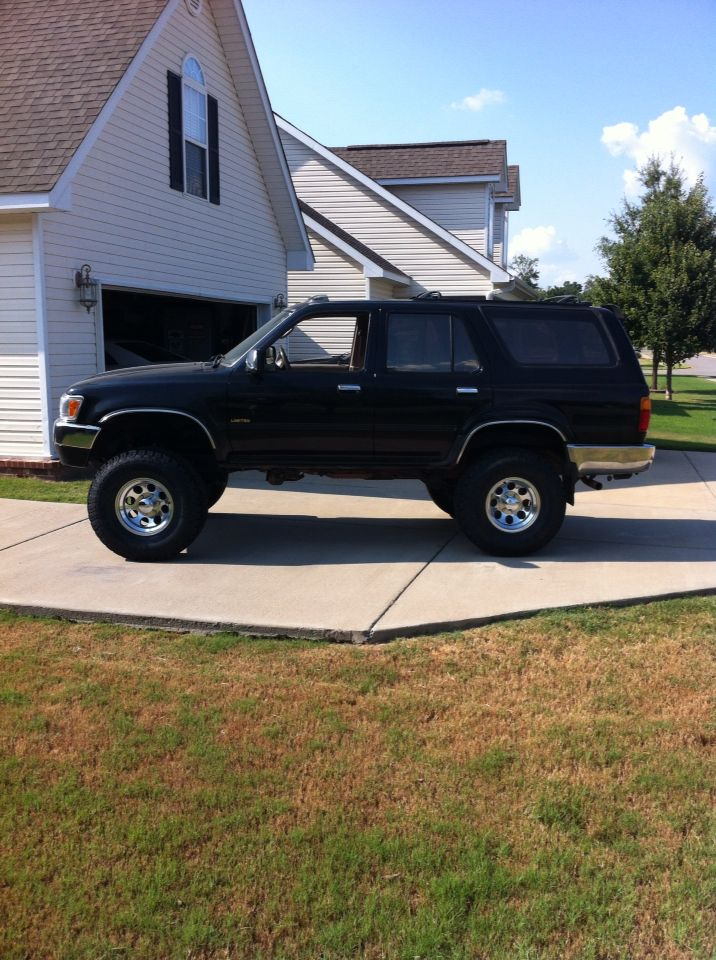 """1995 Toyota 4Runner. 4"""" Rough Country suspension lift. 33 x 12.5 R 15 General Grabber AT2 tires."""