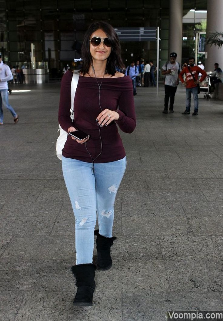 Ileana D'Cruz flashes her cute smile as she walks through Mumbai airport in tight jeans. via Voompla.com