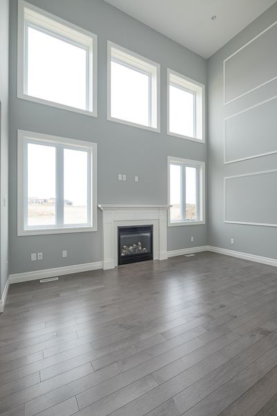 Open-concept 2-storey Great room is a showstopper in our Yorkville III model -look at all that natural light coming in!!! #newhomeconstruction #design #architecture #greatroom #modern #openconcept