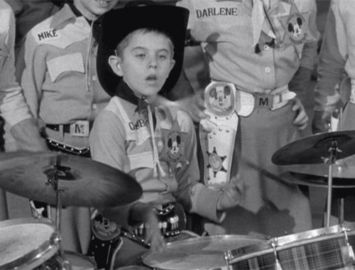 Cubby from The Mickey Mouse Club playing drums, 1955