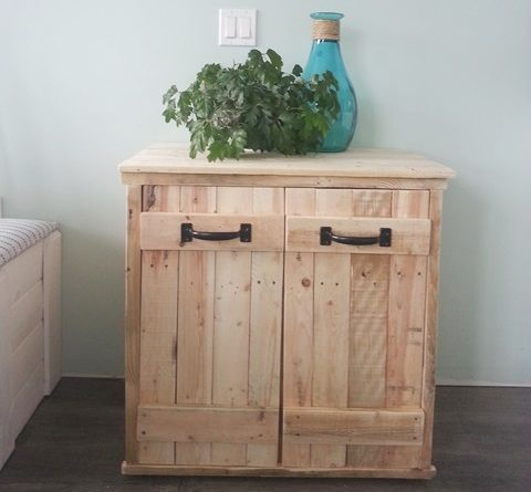 """<strong><a href=""""http://www.instructables.com/id/Garbage-Recycling-Box/"""" target=""""_blank"""">Can you believe this gorgeous recycle bin cabinet was made from pallets?!?</a></strong>"""