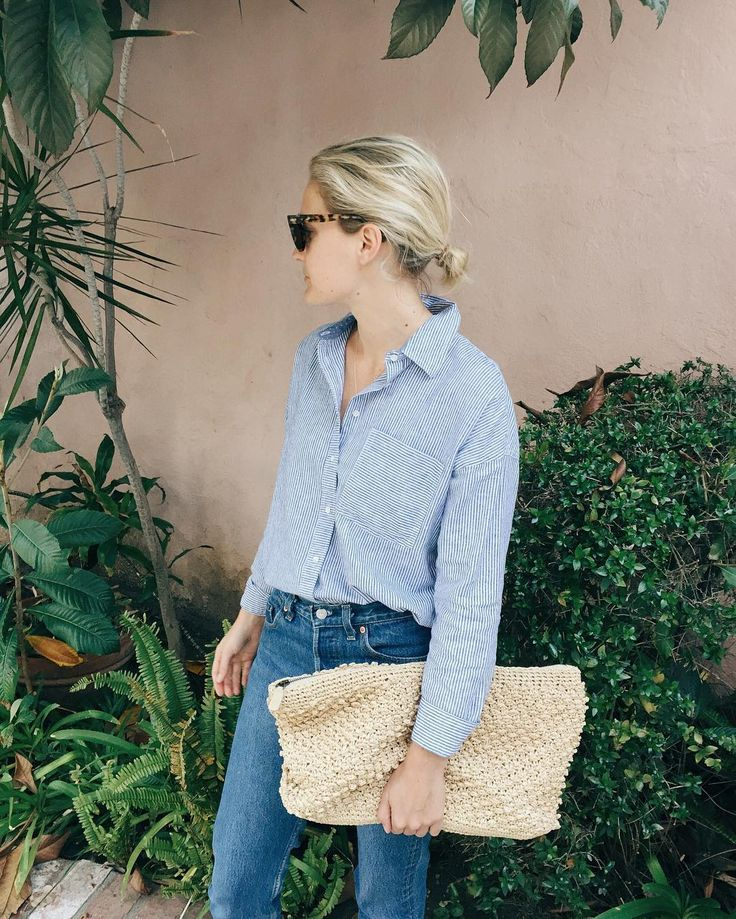 Blue shirt, blue jeans & large clutch | @styleminimalism