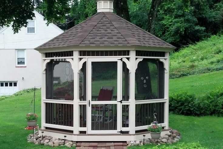 Backyard vinyl gazebo built by the Amish in Lancaster county. The gazebo has a steep shingle roof with a cupola on top.