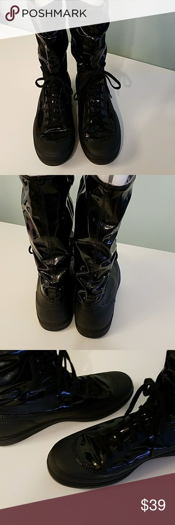 Nike Black Storm Warrior Hi Fashion Sneaker Shoe Size W's 12.  Product number 407482 001.  Made in China.  Barely worn but there are a couple of scuff marks on the right shoe.  Clean inside and out.  A friend who works at Nike says this style was part of a sample line here in the Portland Oregon area.  See photos for actual condition. Nike Shoes Lace Up Boots