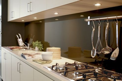 Dark brown glass splashback