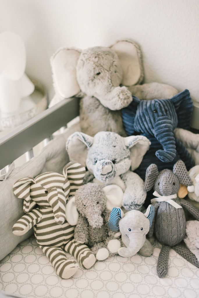 Lots of elephant decor and stuffed animals in this modern baby boy nursery!