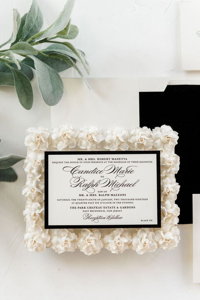 Custom wedding invitation on a bed of handmade paper flowers ...