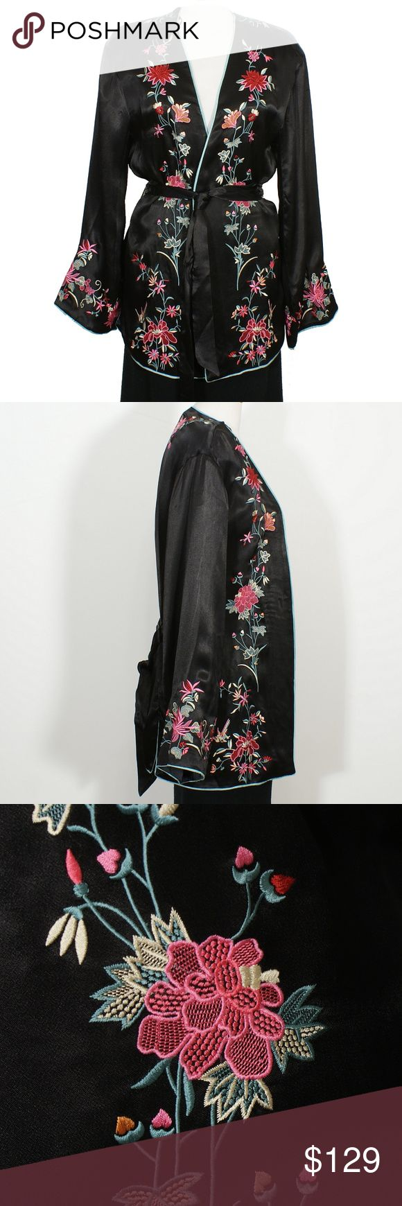 Embroidered Floral Satin Tied Blazer Kimono Jacket This jacket adheres to the bohemian nature. That's further perpetuated with its self-tie profile adorned with an array of embroidered blooms that borrows from the traditional Japanese kimono silhouette. Luxe stain blazer featuring beautiful and colorful floral embroidery  detailing.  It has open front, self tie, vented hem, aqua trim, and wide long sleeves.  Fully Lined.  Material:  100% Viscose, Lining: 100% Polyester Cleaning:  Dry Clean…