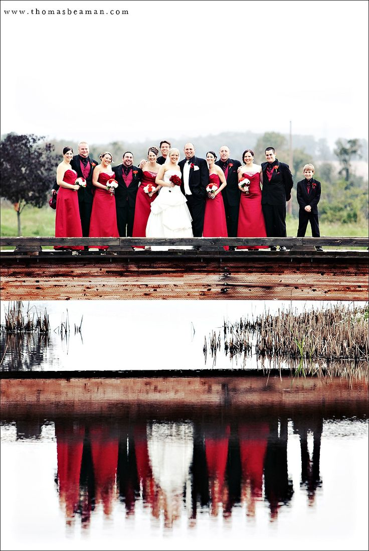Groom with white tie.  The groomsmen with solid red ties instead