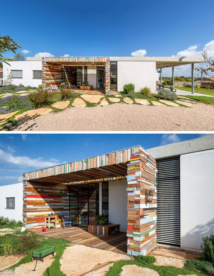 Often white stucco houses are just that, white stucco, but with this house, the white stucco walls have been broken up by an artistic yet function scrap wood element, that makes a fun artistic statement.
