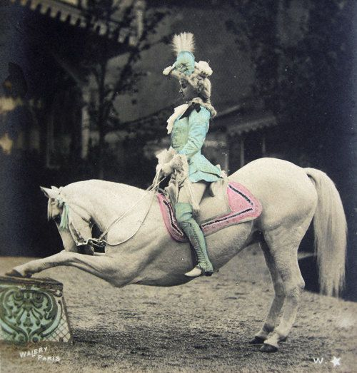 Wonderful and very, very rare this hand tinted French photo postcard of a lady circus artist (Mademoiselle Marville) on her horse. She performed at the Moulin Rouge in Paris the Belle Epoque era (1900-1905).    Photographer: Walery, Paris  Postally not used, with undivided backside so pre-1905
