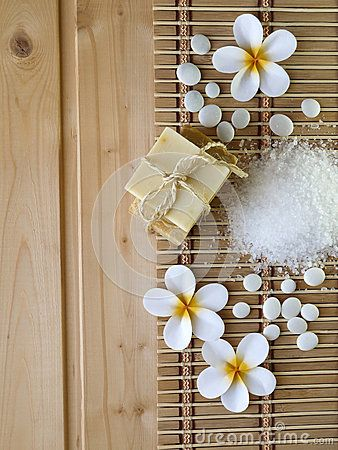 Salt, soap and tiare flowers on the wooden background