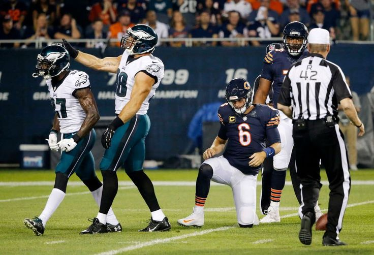 Philadelphia Eagles strong safety Malcolm Jenkins, left, celebrates with inside linebacker Jordan Hicks as Chicago Bears quarterback Jay Cutler gets up after a quarterback sack during the first half of an NFL football game, Monday, Sept. 19, 2016, in Chicago.