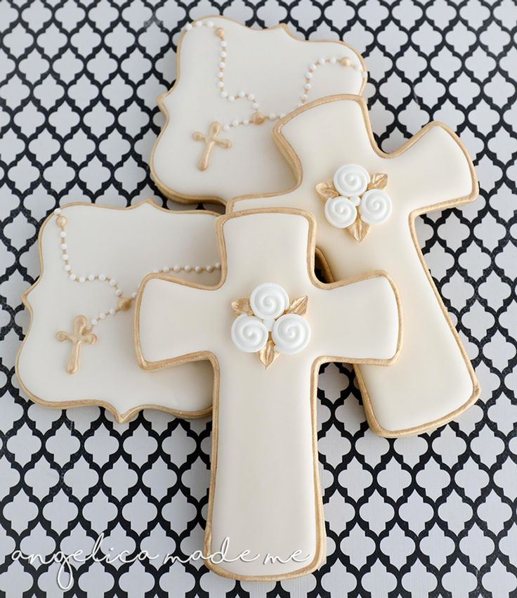 Decorated sugar cookies for a communion. Gold, ivory and a bit of white combine to make classic looking rosary and cross cookies.