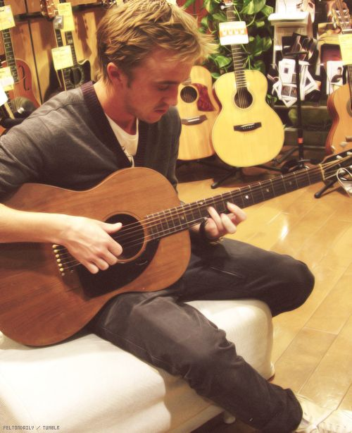Tom Felton. A perfect date with him would be a starry summer night around a fire and him pulling that guitar out and singing me song after song