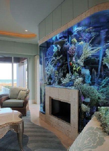 Aquarium surrounding fireplace in living room - Decoist