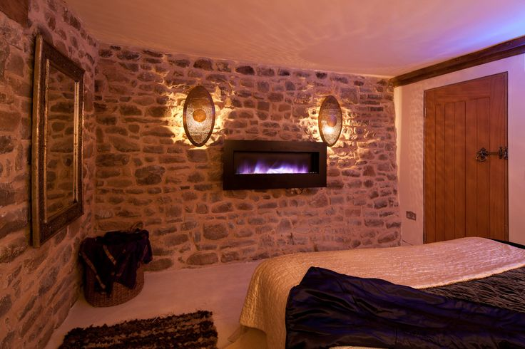 Beautiful bedroom with a gorgeous built in fire to keep you warm in the winter months.    Red Kite Barn luxurious self catering holiday cottage in Builth Wells    Enquire today    www.sheepskinlife.com