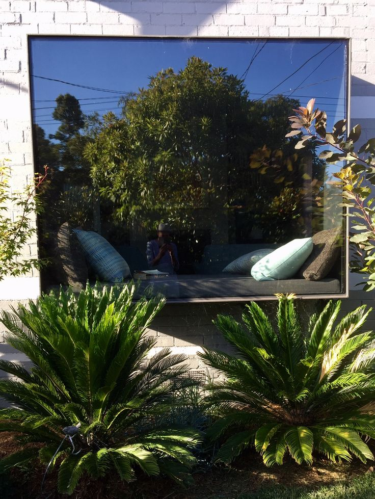 Semi transparent mirror film on a window adds another dimension to the garden making it appear larger than it actually is.