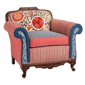 """Featuring a carved hardwood frame and multi-print upholstery, this eye-catching arm chair brings a lively pop of style to your sunroom or den.  Product: ChairConstruction Material: Hardwood frame and mixed fabricsColor: MultiDimensions: 32"""" H x 36"""" W x 30"""" D Cleaning and Care: Spot clean"""