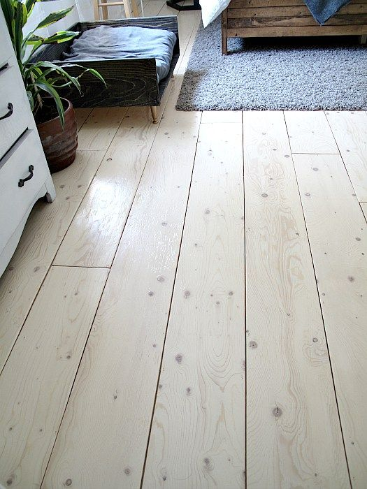 Remove old carpet and lay plywood for a stunning and budget friendly flooring solution!