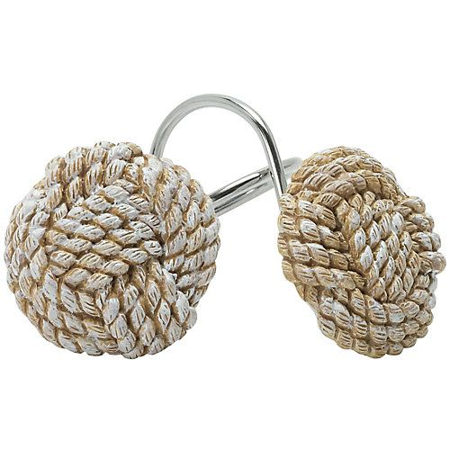 India Ink home accessories bring classic style and traditional aesthetics to your home. This set of shower hooks adds a coastal atmosphere to your home. Features rustic rope-inspired design. 12 hooks measure 2''W x 3''L.