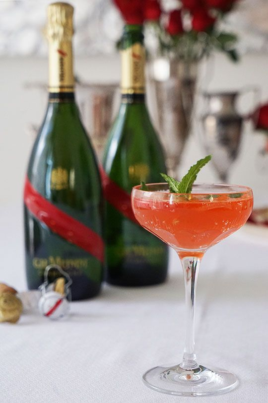 Run For the Roses Champagne Punch Created by Gastronomista  Serves 4  1 bottle of G.H. Mumm Champagne 1 c. Aperol 3/4 c. Rhubarb-Rose Syrup* 1-1/2 c Bourbon 1 Lemon, Juiced 5-6 dashes Orange Bitters  Build in a punch bowl over a large block of ice.  Garnish with lemon wheels, rose petals, and fresh mint.