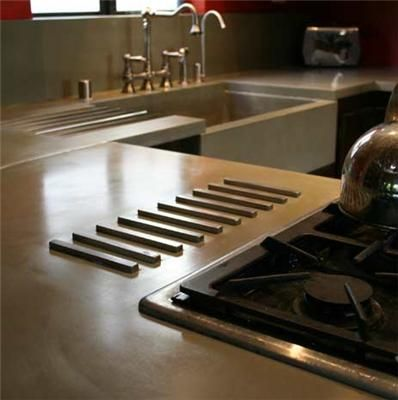One day, I will have concrete countertops with a built in stainless steel trivet!