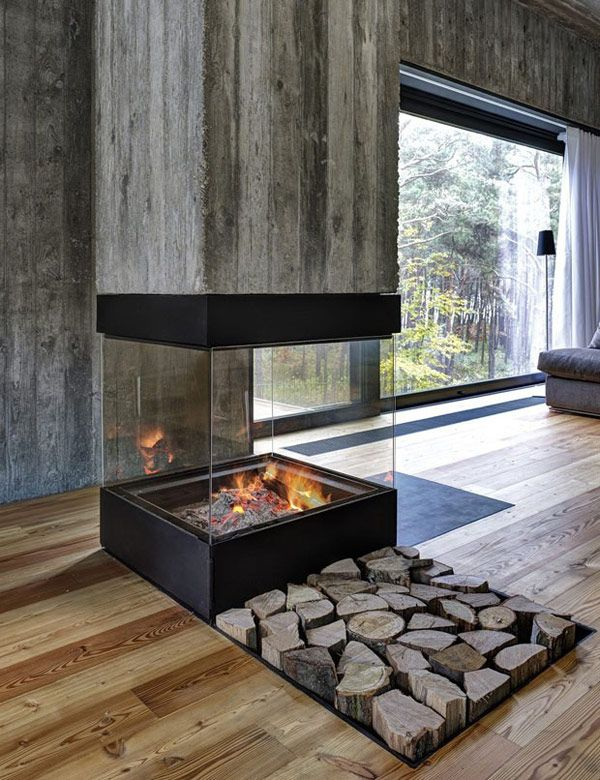 Board formed concrete interior w/ glass fireplace.