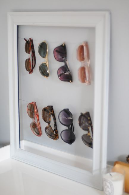 SNAGGED: DIY sunglass display. - this was so easy & actually really useful in our household! (No wire? Temporarily use yarn.. fishing string.. Necklace.....for the super frugal ... The sample dental floss you never used from your last cleaning ;))