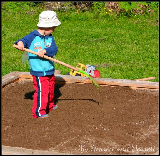 Ultimate Backyard Playground : Raking and playing in the dirt