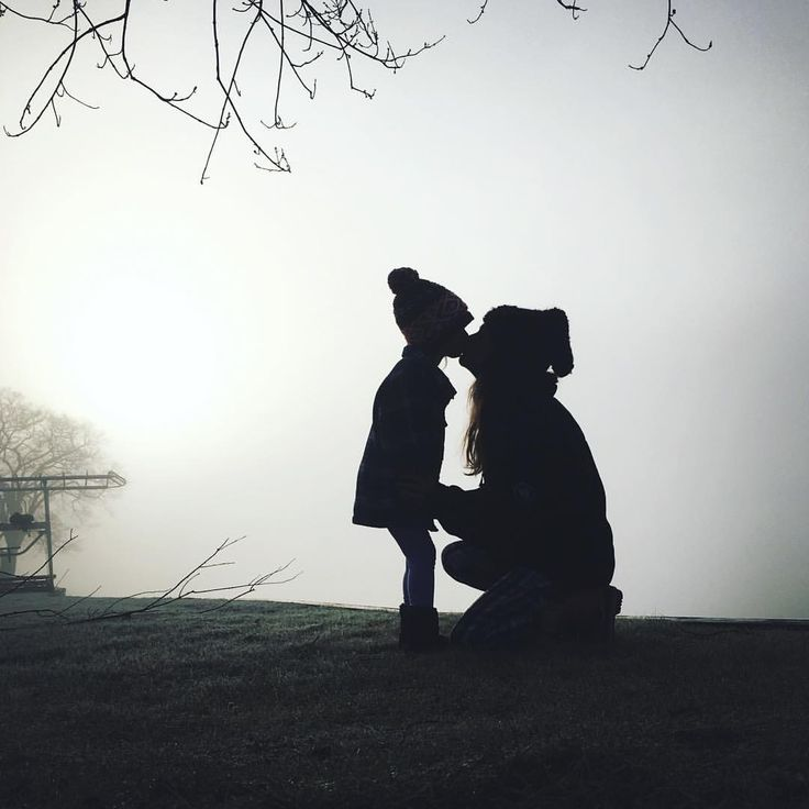 Mother daughter foggy silhouettes