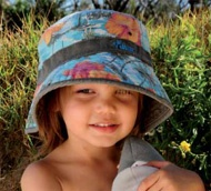 Boys Aloha Bucket - A very stylish boys sun hat. Made from 100% cotton, with a great bucket shape and great wide brim. It has a hawiian aloha print with khaki trim & band. It is fully reversible to show plain khaki material with the aloha print band. It It is easily folded to take anywhere.