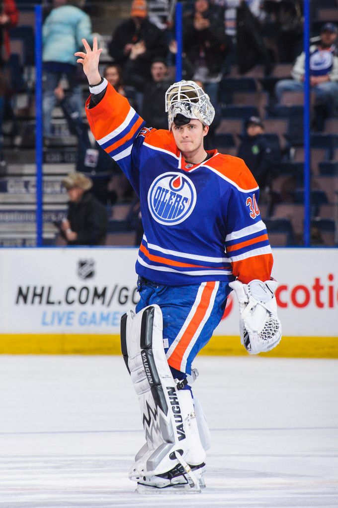 EDMONTON, AB - JANUARY 26: Ben Scrivens #30 of the Edmonton Oilers waves to the crowd after earning the first of three stars after defeating...