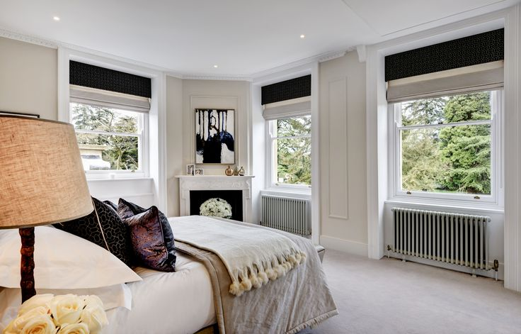 Guest bedroom in Grade II listed converted Georgian manor house designed by www.aji.co.uk with gold and blue accents