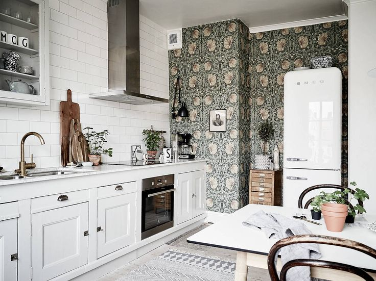Kitchen with green vintage wallpaper