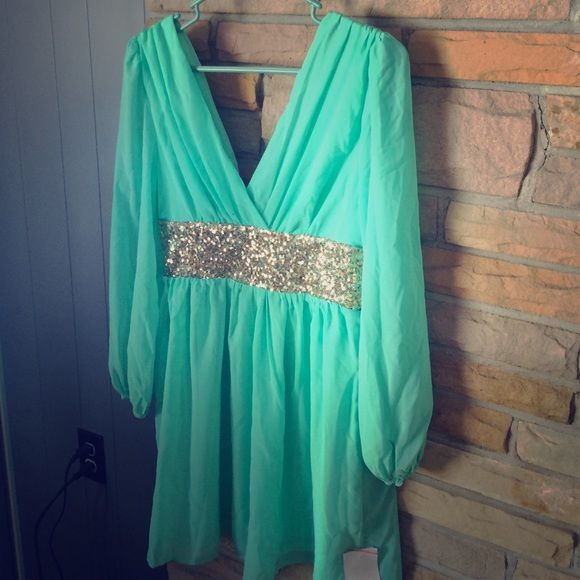 Giddy Up Glamour Sequin Dress Turquoise dress with sequin band. Zips in the back. Never worn!! Would look great with a pair of boots :) Giddy Up Glamour Dresses Long Sleeve