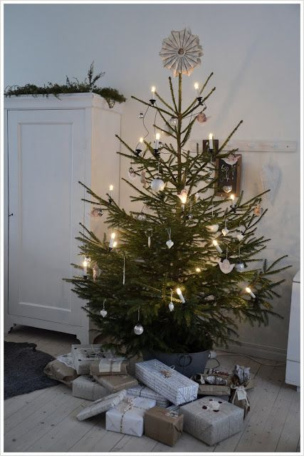 So simple; so beautiful! Christmas tree with white, beige, taupe gift wrapping in a white textural room.