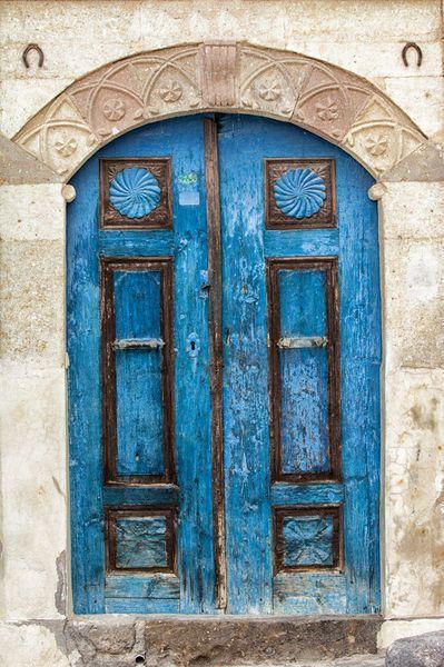 Beautiful blue doors make an impact in Mustafapaşa, Cappadocia, Turkey