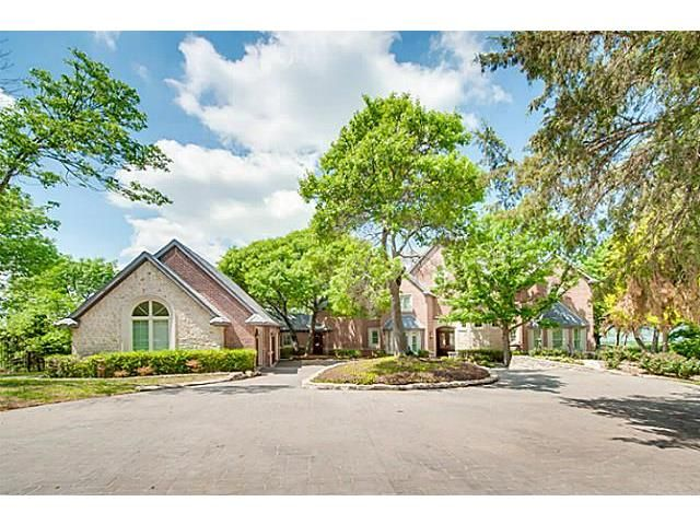 Executive home,wooded acreage overlooking Joe Pool Lake, Mid-Cities, Cowboy Stadium & Ft. Worth skyline.Amazing sunsets in quiet, secluded setting only 30 min from DFW & downtown Dallas, Superior construction in this home with 4 bdrms,4.3 baths,5 living areas & 3 floors,5 fireplaces, 2 din areas & open kitchen, private master suite w balcony & fireplace. Most rooms have panoramic view of lake. covered patio for entertaining ,sport court, & gated