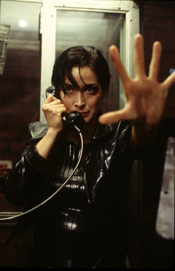 Carrie-Anne Moss as Trinity in the Matrix. Probably one of the coolest female superheroes of all time. All. Time.